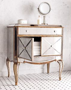 love this mirrored piece with the gold accents