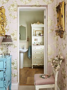 Soft pinks and gold, gives this room a beautiful vintage feel- MiaFleur