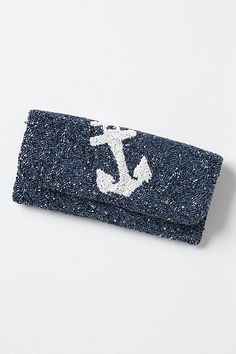 A sparkly navy blue clutch with anchor design #nauticaldesign, #clutch