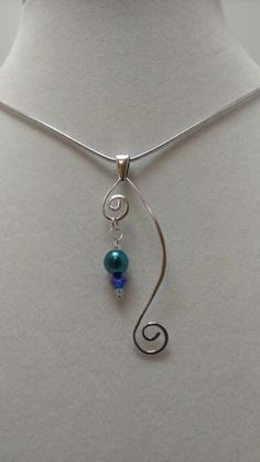 Shaped wire and bead pendant