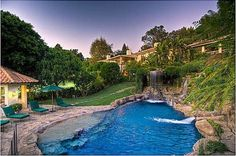 Mark Wahlberg  A waterfall pours into the lagoon-like pool. (Zillow.com)