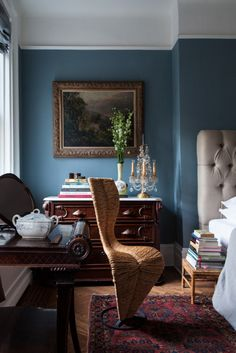 Blend antiques and wood tones against a bold wall color for a stunning background.