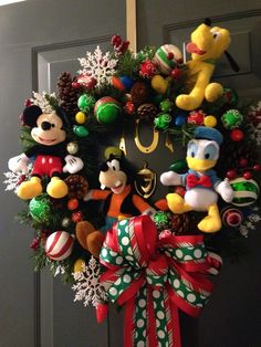 tie your favorite disney characters to a Christmas wreath for original holiday decor! www.mickeytravels.com