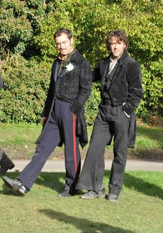 """Jude Law and Robert Downey Jr. during filming of """"Sherlock Holmes: A Game of Shadows. I love it when actors make derp faces. Sherlock Holmes Robert Downey, Robert Downey Jr., Sherlock Bbc, Jude Law, Warner Bros Movies, Holmes Movie, Avengers, Guy Ritchie, Downey Junior"""