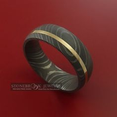 damascus steel with yellow gold inlay. $298