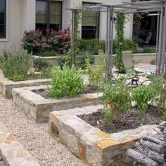 Stone edges and raised beds built with rocks, bricks or decorative concrete stones add charming accents to backyard landscaping and garden design