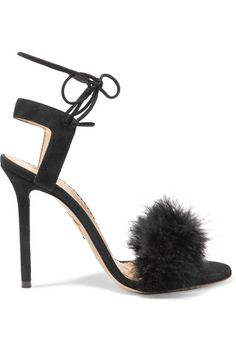 """Charlotte Olympia's shoes are inspired by """"nostalgia for the bygone era of old Hollywood glamor"""". Tying elegantly at the ankle, these Italian-made 'Salsa' sandals are made from black suede and embellished with feathers across the toe. We think they're perfect with an LBD."""