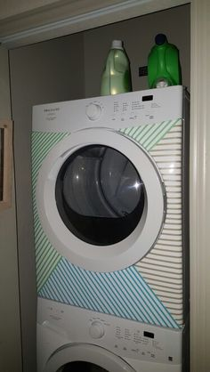 Adding some flair to plain white dryer in the apartment with washi tape