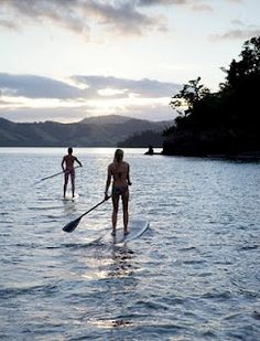 Watch the sun set behind the mountains of Fiji ...from your paddleboard.  #JetsetterCurator