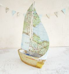 Book Boat with Vintage Map Paper Sails  - Recycled books and papers. £88.00, via Etsy.