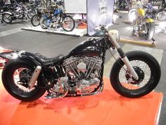 Black shovelhead swingarm custom with early xl nacelle and black rims