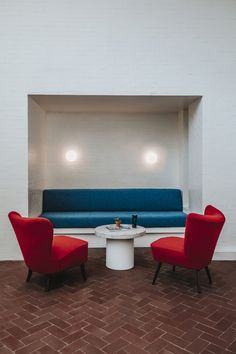 In the lobby: muted red brick floors and white-painted brick walls. Some of the furniture is custom-designed byPablo Limón Design Office.