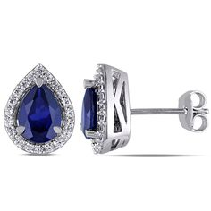 These delightful stud earrings from the Miadora Collection feature pear-cut created blue sapphires surrounded by white sapphires. In 61.96€