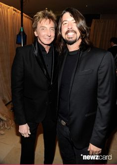 Barry Manilow and Dave Grohl arrives at the 2011 Pre-GRAMMY Gala and Salute To Industry Icons Honoring David Geffen at The Beverly Hilton Hotel on February 12, 2011 in Beverly Hills, California.  (Photo by Kevin Mazur/WireImage)