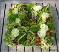 Arrangement in the square with many autumn blooming flowers - Dianthus, Hydrangea, Roses, Poppy seed pods, Blackberries and the small apples and finishing-touch some Amaranthus - how to