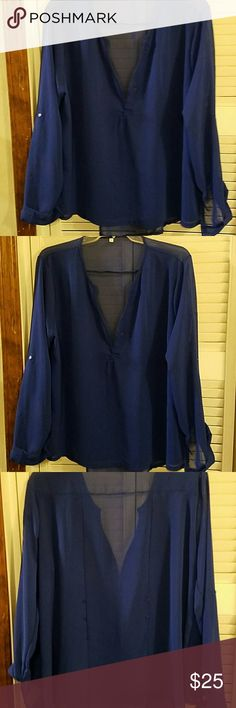 Blouse Very pretty easy wearing it looks great on it says it's an XXL that it actually fits like an extra large is very comfortable this one's mine you might see a tiny spot on it but the one that I'm selling is still brand new and the bag Tops Blouses