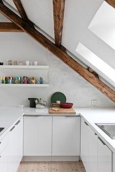 White kitchen, beams
