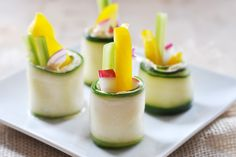 Raw Cucumber Roll-Ups Vegan Gluten-Free- cashew-based cheese spread, peppers, onion, radish, celery. Fancy party appetizer and potluck snack.