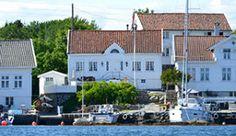 Åkerøya, Kristiansand - hvite hus som ligger helt ute ved havet - Foto: Elisabeth Høibo @ Visit Sørlandet