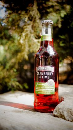The cool, crisp air calls for a Smirnoff Cranberry and Lime Malt Mixed Drink! #Smirnoff #vodka #cranberry #lime #drink #drinkrecipe #fall