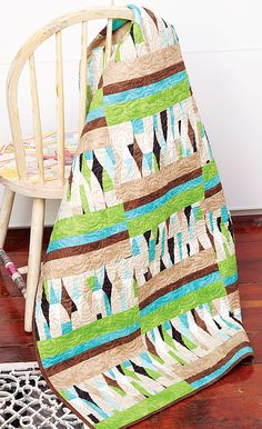 Looking for strip quilts? You've come to the right place! A focus print that looks like patchwork is the main attraction in Echo, by Tricia Lynn Maloney. Strip piecing makes this throw quilt so quick to assemble, you'll be amazed.
