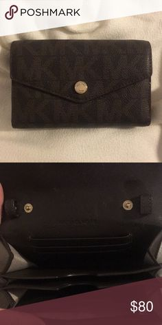 Michael Kors wallet I have been using this wallet for the last couple years, but it is in very good condition. Wallet is real. Bought from Michael Kors Store. Make an offer!! Michael Kors Accessories Key & Card Holders