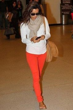 White shirt orange pants and my white and black poke-a- dot scarf