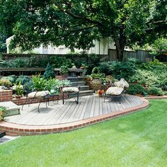 Extend Your Patio  -      Patios and decks are great for entertaining but aren't always large enough to host a crowd. Here, a patch of level lawn expands the outdoor living area created by a ground-level patio. This principle would also work with a low deck that allows easy access to the lawn.