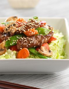 A bed of Fresh Express Shreds becomes a special Stir Fry Beef  Salad with the addition of tender sirloin and mixed Asian  vegetables. #freshexpress #salad