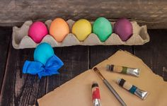 easter eggs with painting brush on old paper ready to paint happy