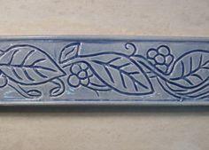 """Ceramic 1 1/2"""" x 6"""" Border Tile -- Flowering Vine Design -- handmade to order by FarRidgeCeramics on Etsy https://www.etsy.com/listing/122333888/ceramic-1-12-x-6-border-tile-flowering"""
