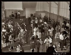 Saturday Night: January 1942. Community house Saturday night dance in the Farm Security Administration settlement of Woodville, California. Medium format safety transparency by Russell Lee for the Farm Security Administration.