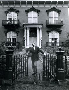 Jim Williams, the first man to be tried for murder four times in the state of Georgia, standing in front of the Mercer House in Savannah, 1980.