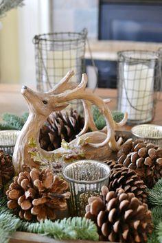 Reindeer pine cone and greenery centerpiece arrangement