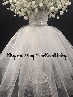 The Event Fairy is pleased to present a new item to our shop on Etsy! Couture Centerpieces will add the touch of wow and ambiance to your tablescape at your event. These elegant tulle dresses cascade over a cut glass base with a 6 vase in a 4 1/2 base. Add your own floral bouquet to top