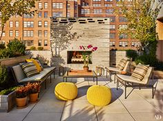 Lovely stacked stone #fireplace atop a rooftop #terrace with a city view