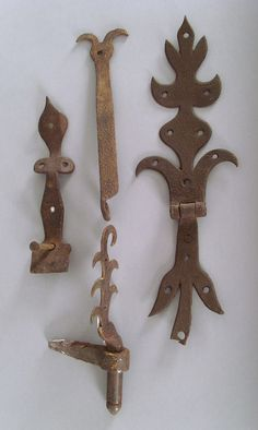 "Pook & Pook.  April 18th 2008. Lot 725.  Estimated: $400 - $600. Realized Price: $351. Elaborate Pennsylvania wrought iron hasp, late 18th c., 14"" l., together with 3 pieces of hardware."