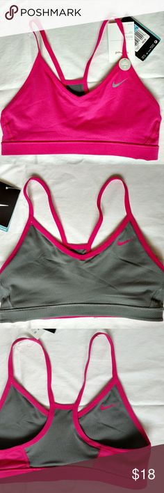 NWT Reversible Nike Sports Bra Cute sports bra, new with tags (the price tag has since been stopped off! But size tag still is attached). Pink and grey and reversible. Nike Tops