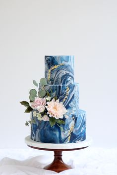 textured navy marble fondant with gold leaf and sugar flowers including su. Stone textured navy marble fondant with gold leaf and sugar flowers including su.,Stone textured navy marble fondant with gold leaf and sugar flowers including su. Navy Cakes, Blue Cakes, Wedding Cake Decorations, Wedding Cake Designs, Beautiful Cakes, Amazing Cakes, Lemon And Coconut Cake, Fondant Wedding Cakes, Blue Wedding Cakes