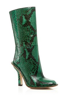 One of fashion's preeminent designers, Consuelo Castiglioni crafts artful, intellectual fashion for **Marni**, the label she founded in 1994 to complement her husband's fur business. Crafted in emerald green python with a tapered toe, these **Marni** boots are a colorful cool weather addition.