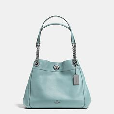 ed8f33e82a52 Shop The COACH Turnlock Edie Shoulder Bag In Polished Pebble Leather. Dark  gunmetal Cloud