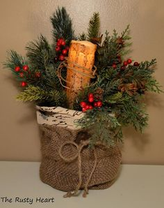 """*Item sold*   - Use a coffee can to support This Burlap Bag is filled with various pines, berries, and naturals. It comes with a Battery Operated Candle wrapped in grapevine. The candle has a 4 or 8 hour timer on it. Candle requires 2 """"AA"""" Batteries (not included). It measures with pine appx. 11""""W x 15""""H. The base of the bag is about 6 1/2""""W."""