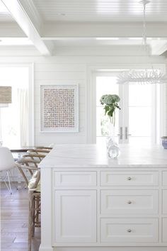 white kitchen design by Collins Interiors | unique vases and art by Phil Durst from blue print | blueprintstore.com