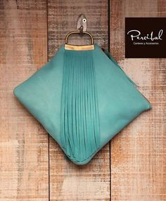 This aqua leather clutch is a perfect accessory to bring an edgy twist to a basic outfit. Its size is really practical: you can fit in your cell phone, your make-up, a small purse, your keys… It is also ideal for honoring the best bridesmaids :) Hand made in genuine leather. Inside: