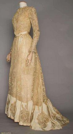 """""""BATTENBURG LACE TEA GOWN, c. 1905 2-piece, mesh cartouches w/ applique blossoms inset into Battenburg lace, silk satin hem, B 36"""", W 22.5"""", L 43""""-58"""", excellent."""" (quote) via augusta-auction.com"""