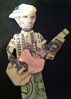 money origami shirt, tie, guitar, and Abe Lincoln head