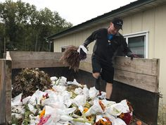 Some hard work, but with a smile, as we pull together a truckload of bouquets