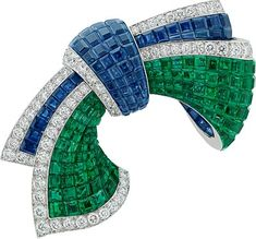 Van Cleef &Arpels Cascade Mystérieuse necklace and detachables clips, white gold, round, pear-shaped, marquise-cut and baguette-cut diamonds, baguette-cut emeralds, one round sapphire, baguette-cut sapphires, 28 pear-shaped sapphires for 66.47 carats (origin: Madagascar), red gold, Traditional Mystery Set emeralds and sapphires