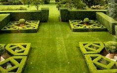 Love the symmetry.  (via Landscape Designs / English style hedge garden on Lily Pond Lane, East Hampton, NY.)