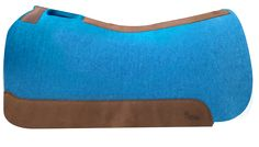 The 5 Star Performer Pad in Turquoise is our full skirted pad. It is a great pad for Ropers, Cutters, Reiners, Trail Riders, and is great for Larger Skirted Saddles. The back is slightly rounded to make room for the hip. The 100% pure virgin wool felt wicks away moisture, cleans up easily and stabilizes your saddle with limited cinching. Wear leathers provide protection and durability. Hand-made in the USA!